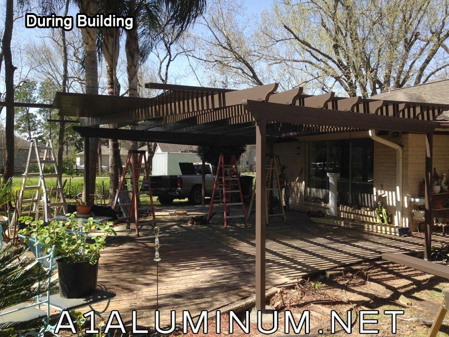 Brown Aluminum Patio Covers : PergolaDuringBuilding from www.scrapinsider.com size 900 x 675 jpeg 416kB